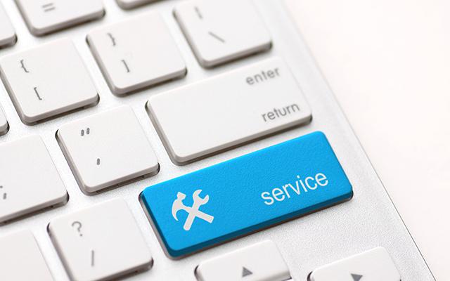 Blaue Service-Teste auf einer Tastatur